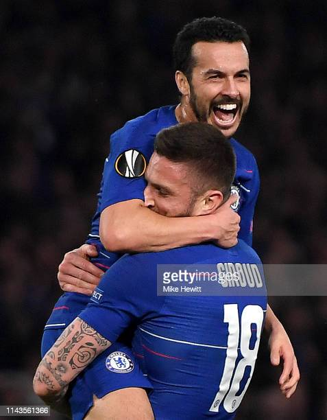 Olivier Giroud of Chelsea celebrates scoring his sides third goal with Pedro during the UEFA Europa League Quarter Final Second Leg match between...