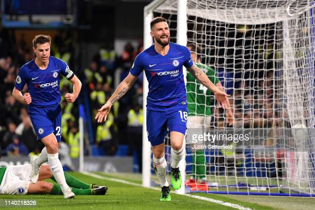Olivier Giroud of Chelsea celebrates scoring the 1st Chelsea goal with team mates during the Premier League match between Chelsea FC and Brighton...