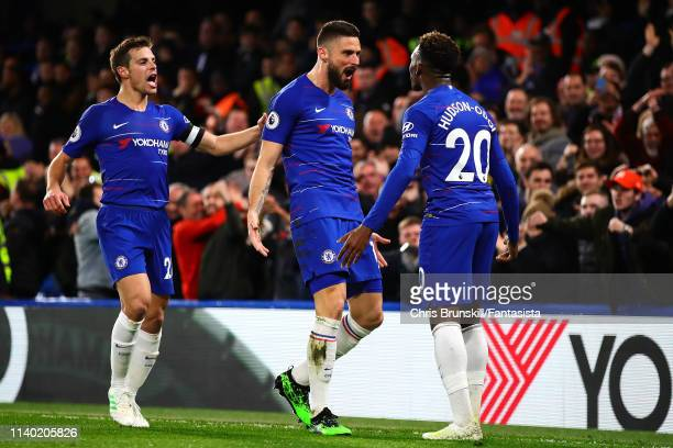 Olivier Giroud of Chelsea celebrates scoring the opening goal with teammate Callum HudsonOdoi during the Premier League match between Chelsea FC and...