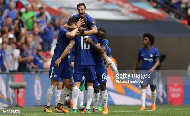 Olivier Giroud of Chelsea celebrates scorinmg the first goal with team mates during the The Emirates FA Cup Semi Final match between Chelsea and...