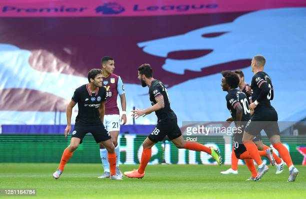 Olivier Giroud of Chelsea celebrates with his team after he scores his teams second goal during the Premier League match between Aston Villa and...