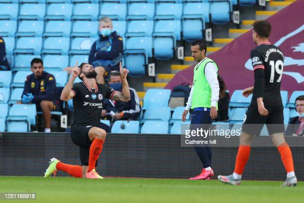 Olivier Giroud of Chelsea celebrates with his team after scoring his sides second goal during the Premier League match between Aston Villa and...