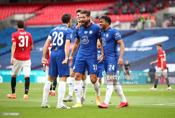 Olivier Giroud of Chelsea celebrates with his team after scoring his sides first goal during the FA Cup Semi Final match between Manchester United...