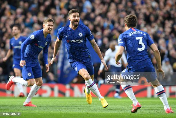 Olivier Giroud of Chelsea celebrates with Marcos Alonso after scoring his team's first goal during the Premier League match between Chelsea FC and...