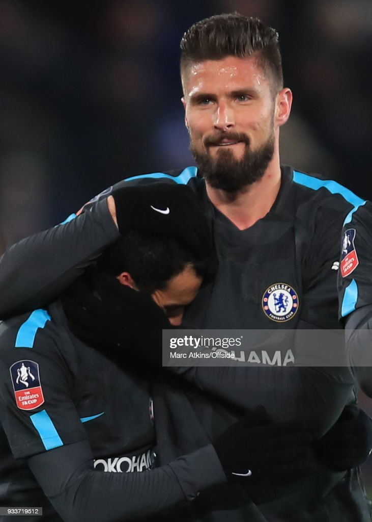 Olivier Giroud of Chelsea celebrates with Pedro during the Emirates FA Cup Quarter Final match between Leicester City and Chelsea at The King Power Stadium on March 18, 2018 in Leicester, England.