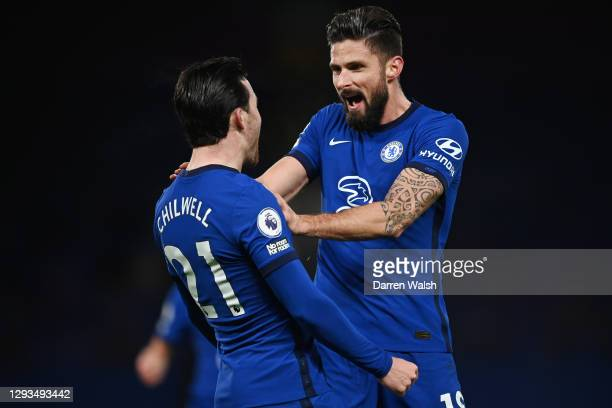 Olivier Giroud of Chelsea celebrates with team mate Ben Chilwell after scoring their sides first goal during the Premier League match between Chelsea...