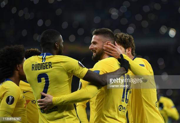 Olivier Giroud of Chelsea celebrates with teammate Antonio Ruediger after scoring his third and his team's fourth goal during the UEFA Europa League...