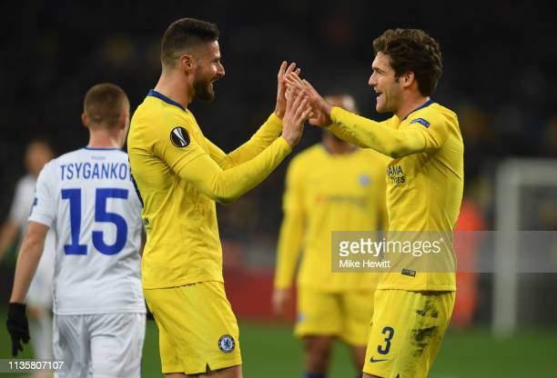 Olivier Giroud of Chelsea celebrates with teammate Marcos Alonso after scoring his team's second goal during the UEFA Europa League Round of 16...