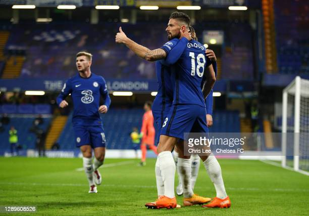 Olivier Giroud of Chelsea celebrates with teammate Reece James after scoring their team's first goal during the Premier League match between Chelsea...