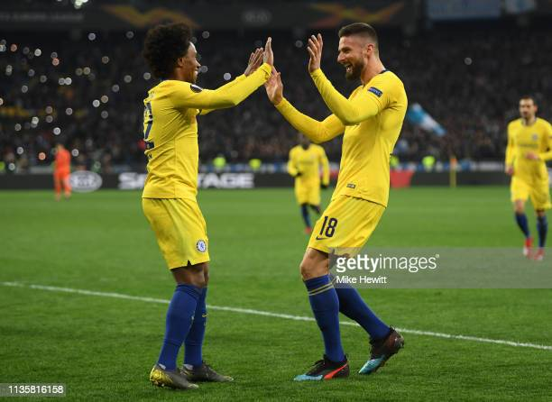 Olivier Giroud of Chelsea celebrates with teammate Willian after scoring his third and his team's fourth goal during the UEFA Europa League Round of...