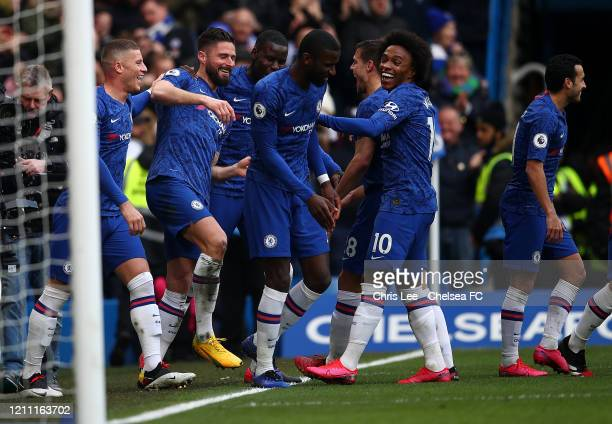 Olivier Giroud of Chelsea celebrates with teammates after scoring his team's fourth goal during the Premier League match between Chelsea FC and...