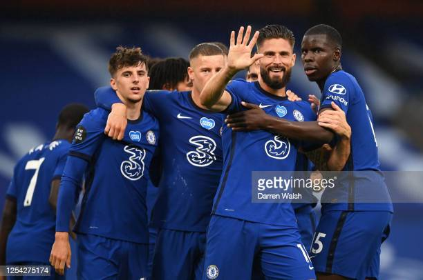 Olivier Giroud of Chelsea celebrates with teammates after scoring his team's first goal during the Premier League match between Chelsea FC and...
