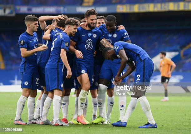 Olivier Giroud of Chelsea celebrates with teammates after scoring his team's second goal during the Premier League match between Chelsea FC and...