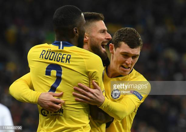 Olivier Giroud of Chelsea celebrates with teammates Antonio Ruediger and Andreas Christiansen after scoring his team's first goal during the UEFA...