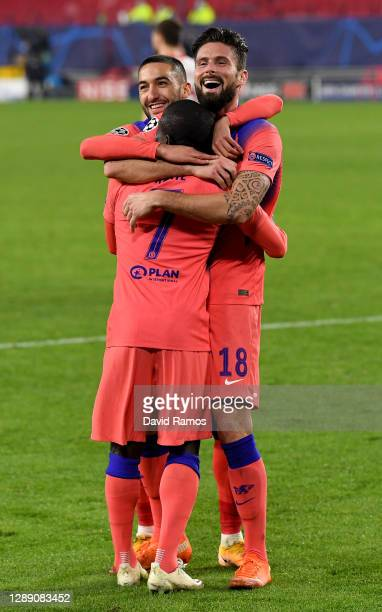 Olivier Giroud of Chelsea celebrates with teammates Hakim Ziyech and Ngolo Kante after scoring their team's third goal, their hat-trick during the...