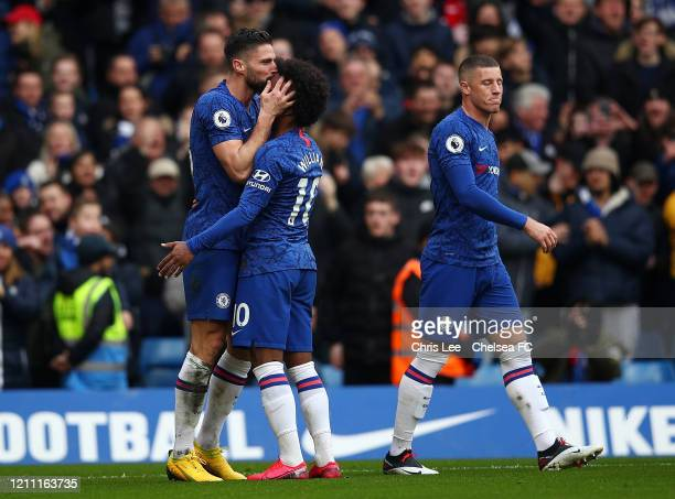 Olivier Giroud of Chelsea celebrates with Willian after scoring his team's fourth goal during the Premier League match between Chelsea FC and Everton...