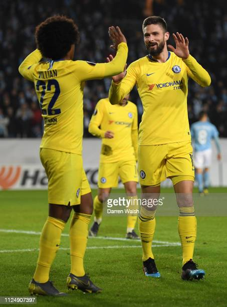 Olivier Giroud of Chelsea celebrates with Willian of Chelsea after he scores his sides second goal during the UEFA Europa League Round of 32 First...