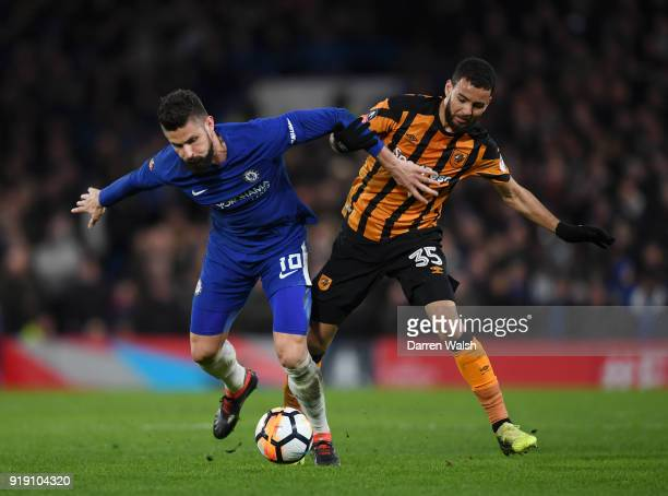 Olivier Giroud of Chelsea gets to the ball ahead of Kevin Stewart of Hull City during the Emirates FA Cup Fifth Round match between Chelsea and Hull...