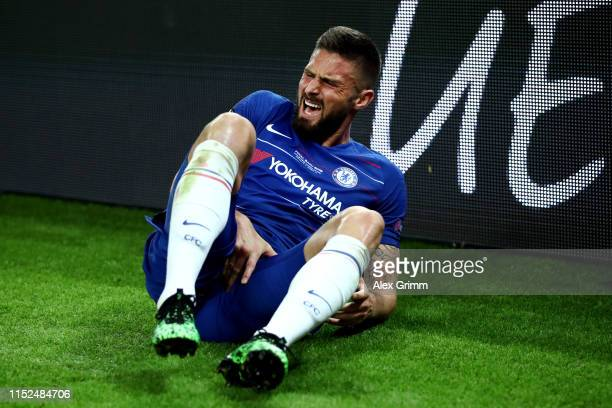 Olivier Giroud of Chelsea goes down holding his groin during the UEFA Europa League Final between Chelsea and Arsenal at Baku Olimpiya Stadionu on...