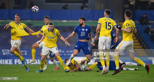 Olivier Giroud of Chelsea heads goalwards during the Premier League match between Chelsea and Brighton & Hove Albion at Stamford Bridge on April 20,...