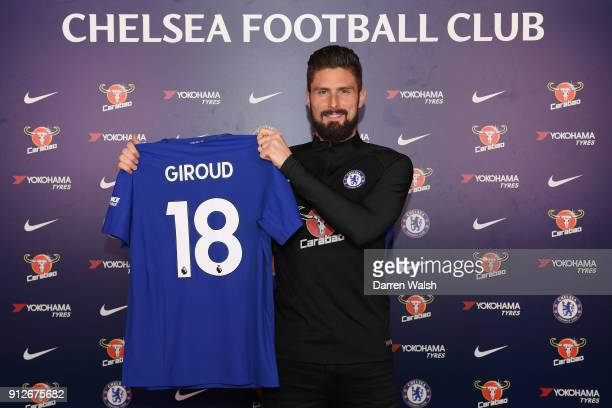 Olivier Giroud of Chelsea holds his new shirt at Chelsea Training Ground on January 31 2018 in Cobham England