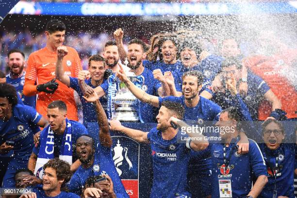 Olivier Giroud of Chelsea holds the Emirates FA Cup trophy in celebration of his side's win with team mates following The Emirates FA Cup Final...