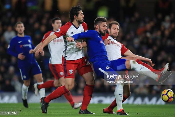 Olivier Giroud of Chelsea in action with Ahmed Hegazi and Craig Dawson of West Bromwich Albion during the Premier League match between Chelsea and...