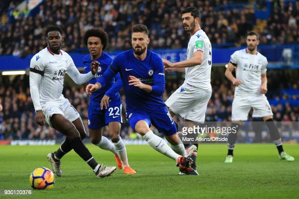Olivier Giroud of Chelsea in action with Jeffrey Schlupp and James Tomkins of Crystal Palace during the Premier League match between Chelsea and...