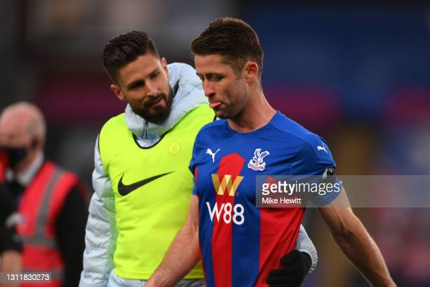 Olivier Giroud of Chelsea interacting with Gary Cahill of Crystal Palace after the Premier League match between Crystal Palace and Chelsea at...