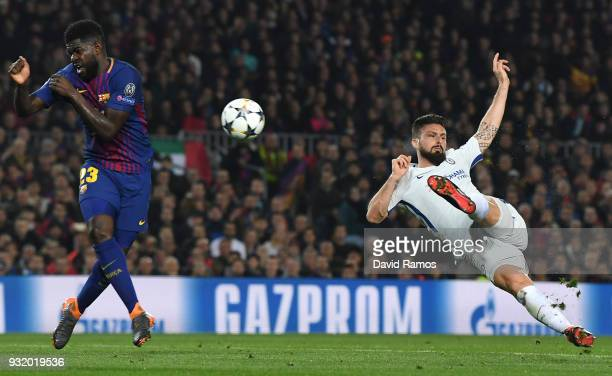 Olivier Giroud of Chelsea is blocked by Samuel Umtiti of Barcelona during the UEFA Champions League Round of 16 Second Leg match FC Barcelona and...