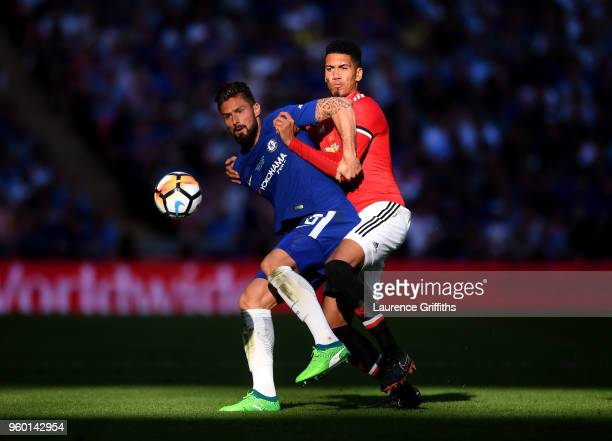 Olivier Giroud of Chelsea is challenged by Chris Smalling of Manchester United during The Emirates FA Cup Final between Chelsea and Manchester United...