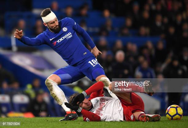 Olivier Giroud of Chelsea is challenged by Grzegorz Krychowiak of West Bromwich Albion during the Premier League match between Chelsea and West...