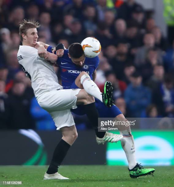 Olivier Giroud of Chelsea is challenged by Martin Hinteregger of Frankfurt during the UEFA Europa League Semi Final Second Leg match between Chelsea...