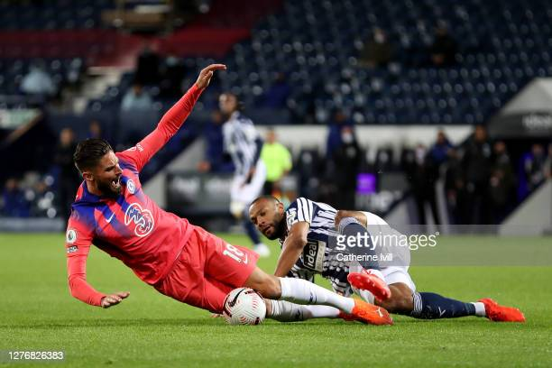 Olivier Giroud of Chelsea is challenged by Matt Phillips of West Bromwich Albion during the Premier League match between West Bromwich Albion and...