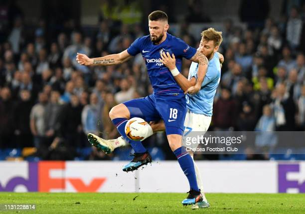 Olivier Giroud of Chelsea is challenged by Rasmus Bengtsson of Malmo during the UEFA Europa League Round of 32 Second Leg match between Chelsea and...
