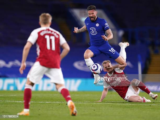 Olivier Giroud of Chelsea is challenged by Rob Holding of Arsenal during the Premier League match between Chelsea and Arsenal at Stamford Bridge on...