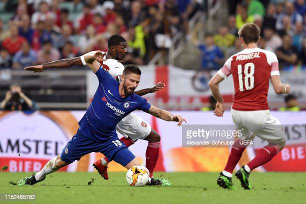 Olivier Giroud of Chelsea is fouled by Ainsley MaitlandNiles of Arsenal and a penalty is later awarded during the UEFA Europa League Final between...