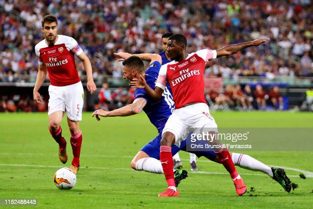 Olivier Giroud of Chelsea is fouled by Ainsley MaitlandNiles of Arsenal in the penalty area leading to a penalty during the UEFA Europa League Final...