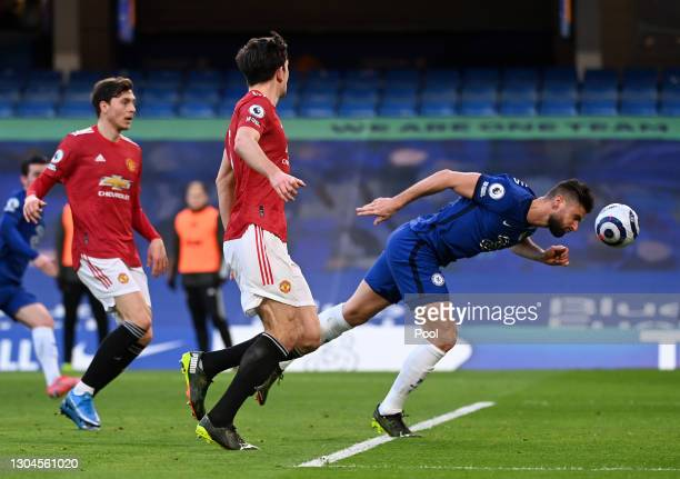 Olivier Giroud of Chelsea leaps to win a header during the Premier League match between Chelsea and Manchester United at Stamford Bridge on February...