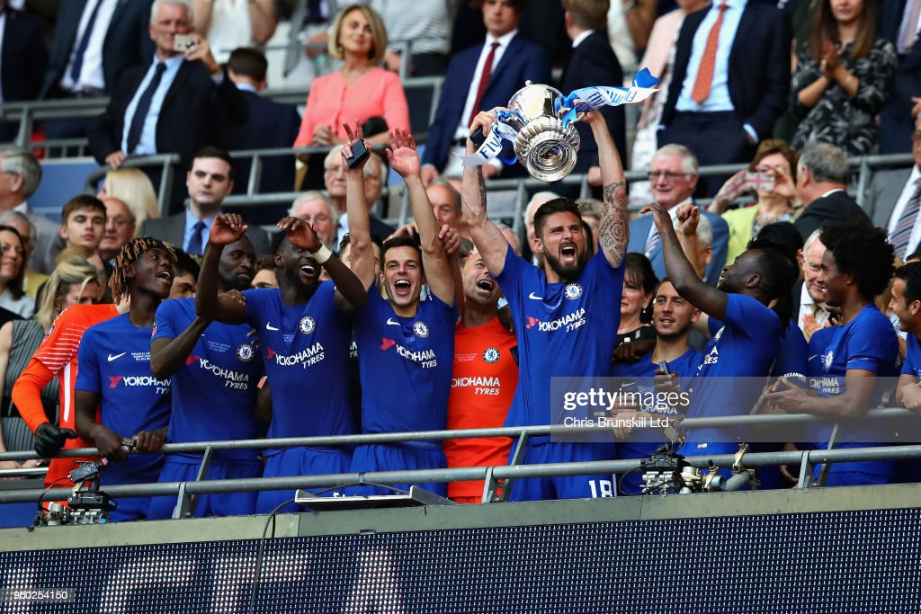 Olivier Giroud of Chelsea lifts the FA Cup trophy after his side won during the Emirates FA Cup Final between Chelsea and Manchester United at Wembley Stadium on May 19, 2018 in London, England.