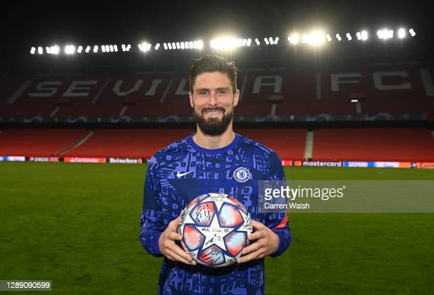 Olivier Giroud of Chelsea poses with the match ball after scoring four goals during the UEFA Champions League Group E stage match between FC Sevilla...