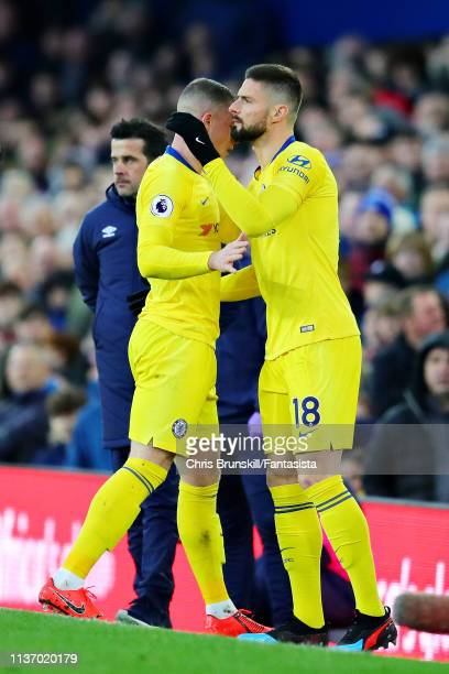 Olivier Giroud of Chelsea replaces teammate Ross Barkley as a substitute during the Premier League match between Everton FC and Chelsea FC at...