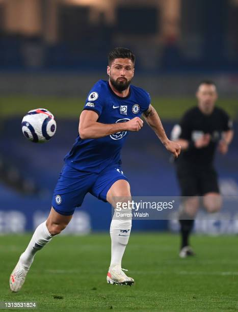 Olivier Giroud of Chelsea runs with the ball during the Premier League match between Chelsea and Brighton & Hove Albion at Stamford Bridge on April...