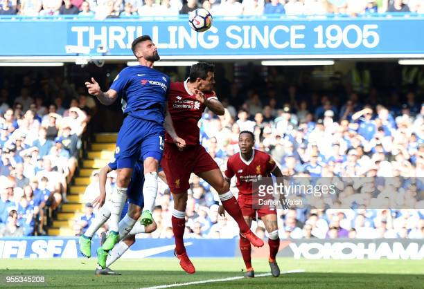 Olivier Giroud of Chelsea scores his sides first goal during the Premier League match between Chelsea and Liverpool at Stamford Bridge on May 6 2018...