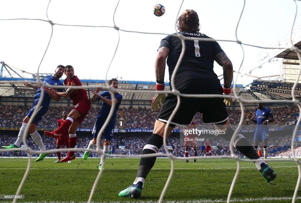 Olivier Giroud of Chelsea scores his sides first goal past Loris Karius of Liverpool during the Premier League match between Chelsea and Liverpool at Stamford Bridge on May 6, 2018 in London, England.