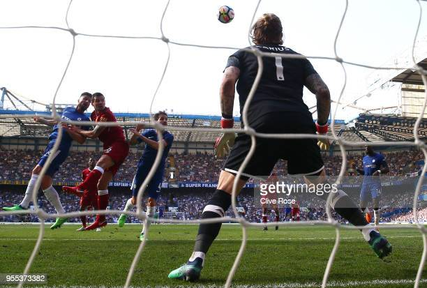 Olivier Giroud of Chelsea scores his sides first goal past Loris Karius of Liverpool during the Premier League match between Chelsea and Liverpool at...