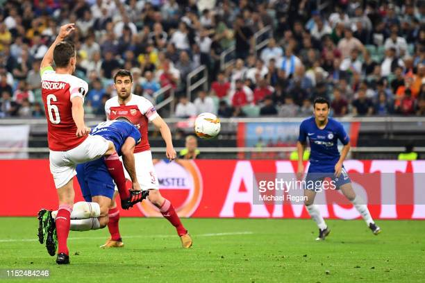 Olivier Giroud of Chelsea scores his team's first goal as he is challenged by Laurent Koscielny of Arsenal during the UEFA Europa League Final...