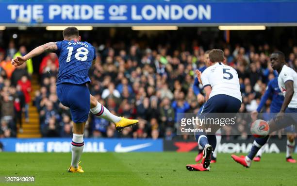 Olivier Giroud of Chelsea scores his team's first goal during the Premier League match between Chelsea FC and Tottenham Hotspur at Stamford Bridge on...