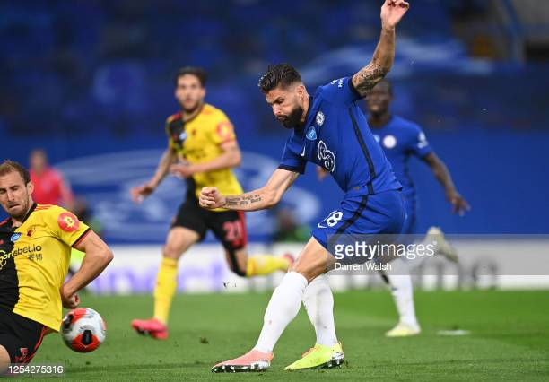 Olivier Giroud of Chelsea scores his team's first goal during the Premier League match between Chelsea FC and Watford FC at Stamford Bridge on July...