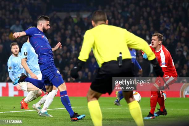 Olivier Giroud of Chelsea scores his team's first goal during the UEFA Europa League Round of 32 Second Leg match between Chelsea and Malmo FF at...